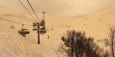 Orange Schnee Saharasand